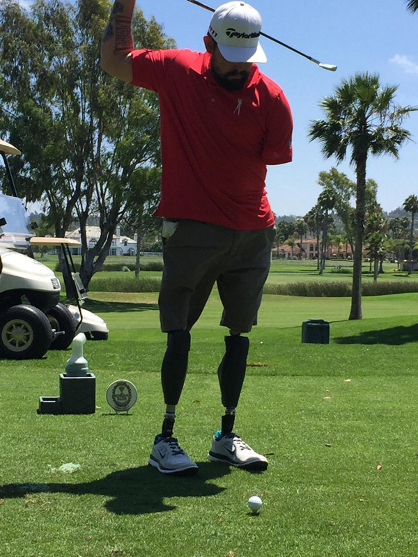Teammate USMC Cpl. Nick Kimmel tees of