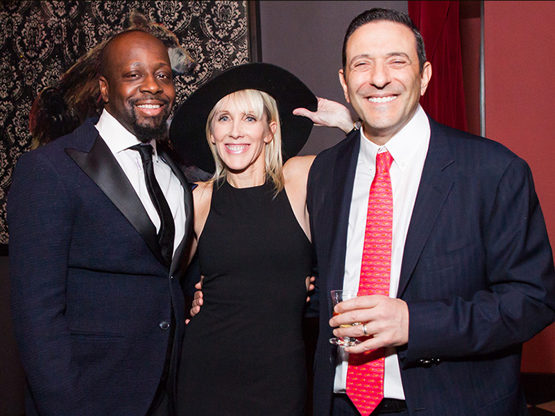 Tom and Linda Rizk with Wyclef Jean