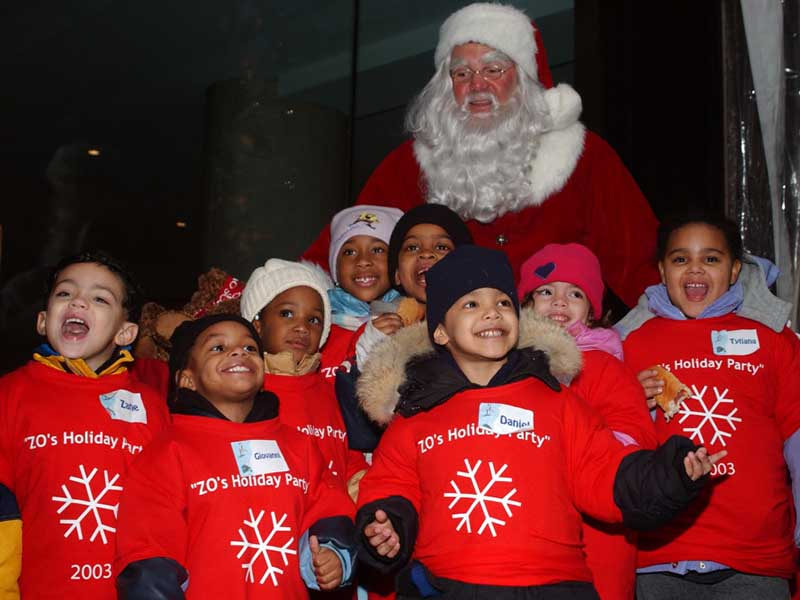 Santa with the children of the York Street Project