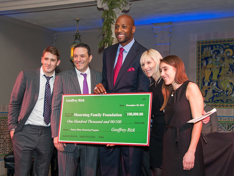 The Rizk Family: (From L to R) Geoff, Tom, Linda, and Alex presenting Alonzo Mourning with a check for The Alonzo Mounring Foundation