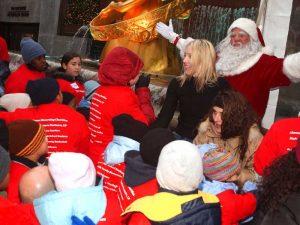 "Santa and Linda Rizk singing ""Jingle Bells"" with the children"