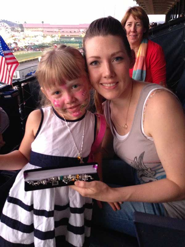 "Military wife and her daughter holding the ""Purple Heart"" bracelet"